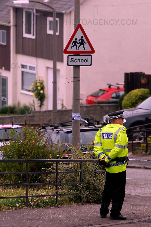 Police in Edinburgh are carrying out inquiries after a 40-year-old man was shot in the early hours of this morning...The man, who is not believed to be suffering from life-threatening injuries, is being treated in Edinburgh Royal Infirmary...He raised the alarm himself after being shot while walking his dog in the Paisley Drive area of the city around 00.40am today (wed, June 24, 2009)...Picture shows a police officer stands guard at the cordoned off Paisley Drive in Edinburgh