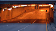 DETROIT - OCTOBER 18: A lone runner goes through the lodge freeway tunnel during the 2015 Detroit Free Press/Talmer Bank Marathon Sunday, October 18, 2015 in downtown Detroit. (Photo by Bryan Mitchell/Special to The Detroit News)