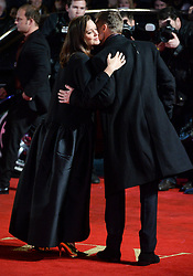 © Licensed to London News Pictures. 21/11/2016. London, UK. BRAD PITT, and  MARION COTILLARD kiss as they arrive at the Allied UK film premiere at Odeon Leicester Square, London. The film follows two assassins who fall in love during a mission to kill a Nazi official during World War II. Photo credit: Ray Tang/LNP