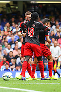 Bafetibis Gomis of Swansea City (18) celebrates the opening goal with team mates during the Barclays Premier League match at Stamford Bridge, London<br /> Picture by David Horn/Focus Images Ltd +44 7545 970036<br /> 13/09/2014