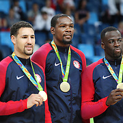 Basketball - Olympics: Day 16   Klay Thompson #11 of United States, Kevin Durant #5 of United States and Draymond Green #14 of United States with their gold medals after the USA Vs Serbia Men's Basketball Gold Medal game at Carioca Arena1on August 21, 2016 in Rio de Janeiro, Brazil. (Photo by Tim Clayton/Corbis via Getty Images)