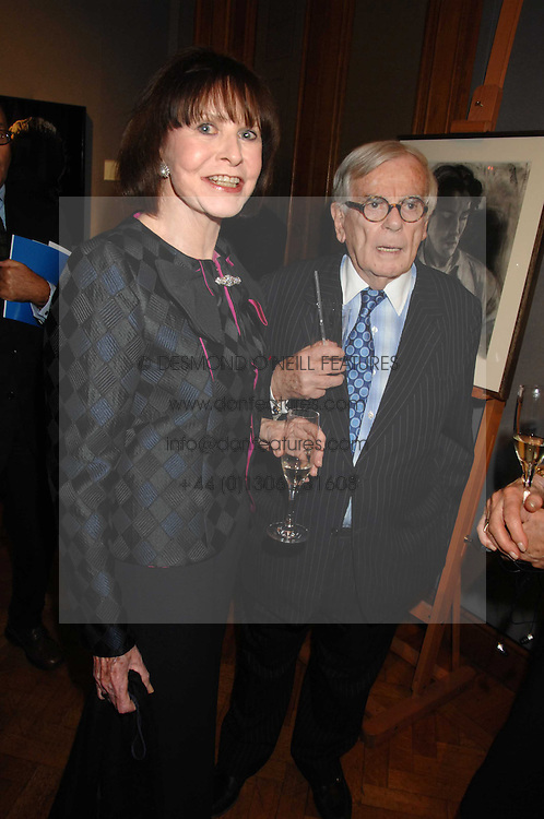 American writer DOMINICK DUNNE and MARGARIETTE LITTMAN at an auction in aid of The Parkinson's Appeal for Deep Brain Stimulation 'Meeting of Minds' held at Christie's, King Street, London SW1 followed by a dinner at St.John, 26 St.John Street, London on 16th October 2007.<br />