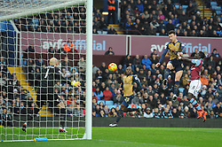 Laurent Koscielny of Arsenal heads towards goal - Mandatory byline: Dougie Allward/JMP - 13/12/2015 - Football - Villa Park - Birmingham, England - Aston Villa v Arsenal - Barclays Premier League