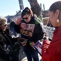 Tamme Williams (left) offers sage and sweet grass for smudging to Susan Becker (center) and Nina Stead (right) before Mary Beth Jennewein's sentencing on Wednesday outside the Minnehaha County Courthouse. Jennewein was sentenced to 25 years in prison for the death of 2-year-old Miles Stead.