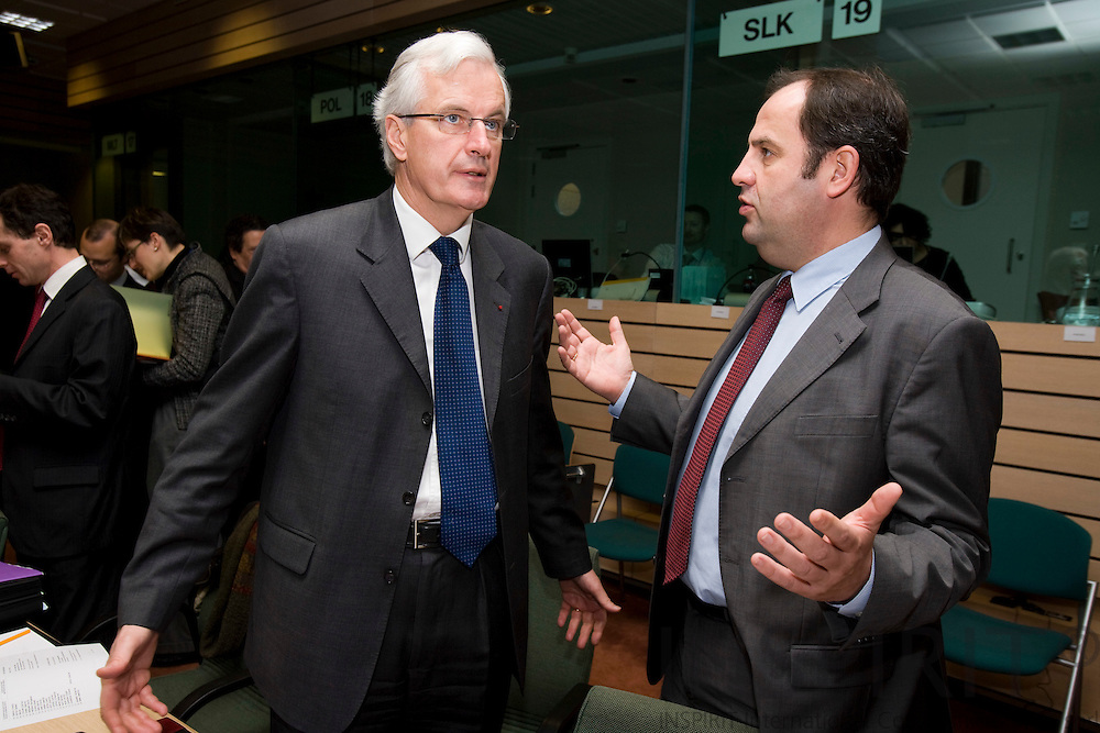 BRUSSELS - BELGIUM - 27 NOVEMBER 2007 -- Michel BARNIER (Le), French Minister of Agriculture, speaking with Josef PROELL (Ri), Minister of Agriculture of Austria, at the beginning of Agriculture and Fisheries council meeting.  Photo: Erik Luntang