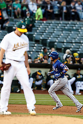OAKLAND, CA - JUNE 14:  Robinson Chirinos #61 of the Texas Rangers rounds the bases after hitting a three run home run off of Eric Surkamp #48 of the Oakland Athletics during the second inning at the Oakland Coliseum on June 14, 2016 in Oakland, California. (Photo by Jason O. Watson/Getty Images) *** Local Caption *** Robinson Chirinos; Eric Surkamp