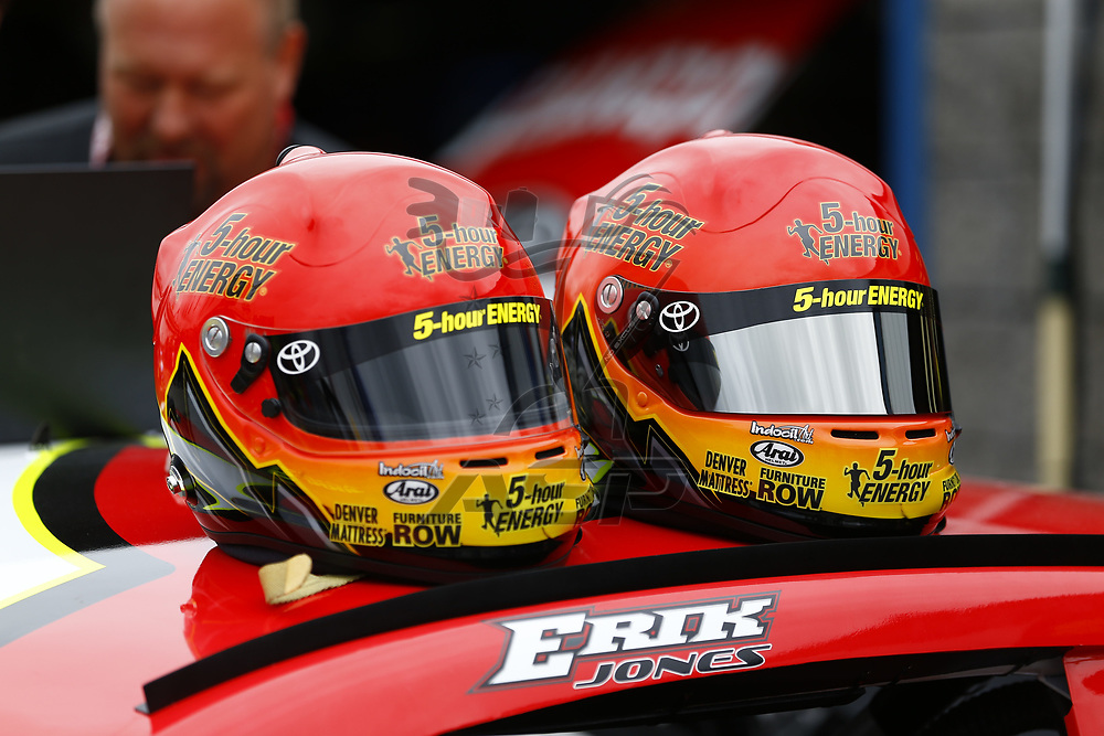 July 14, 2017 - Loudon, NH, USA: The helmets for Erik Jones (77) sit atop his racecar before practice for the Overton's 301 at New Hampshire Motor Speedway in Loudon, NH.