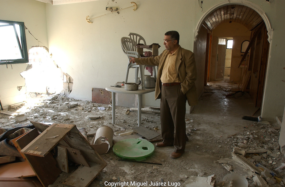 Gaza, palestine.  Dr. Khalid Abuel Alquomsan, Professor at Al Aznar University,  visits his house in the central neighborhood of Tal Alhawa in Gaza city, at the end military campaign by Israel inside Gaza, known as Operation Cast Lead. He has decided not to bring his wife and three children back to the apartment due the dramatic stage of destruction. The conflict resulted in between 1,166 and 1,417 Palestinian and 13 Israeli deaths (4 from friendly fire).  (PHOTO: MIGUEL JUAREZ LUGO).
