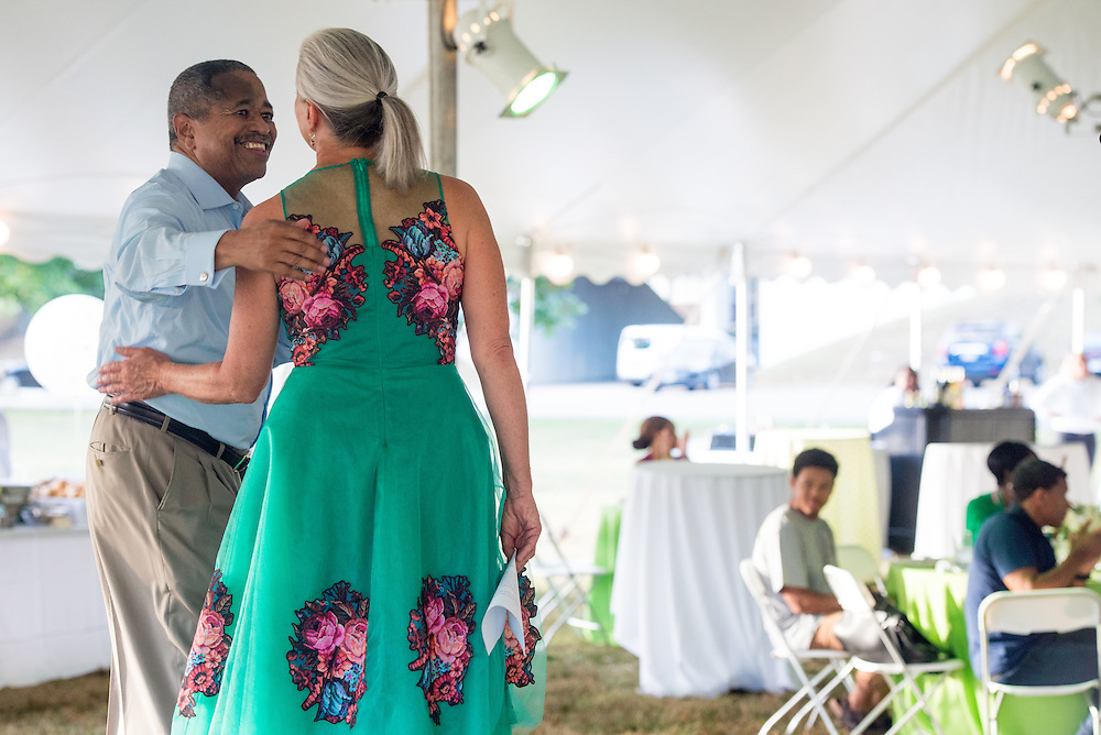 Ohio University President Roderick McDavis congratulates Jennifer Neubauer, Assistant Vice President, during the Black Alumni Reunion during its welcome reception at Tailgreat Park on Thursday, September 15, 2016.