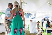 Ohio University President Roderick McDavis congratulates Jennifer Neubauer, Assistant Vice President, during the Black Alumni Reunion during its welcome reception at Tailgreat Park on Thursday, September 15, 2016.