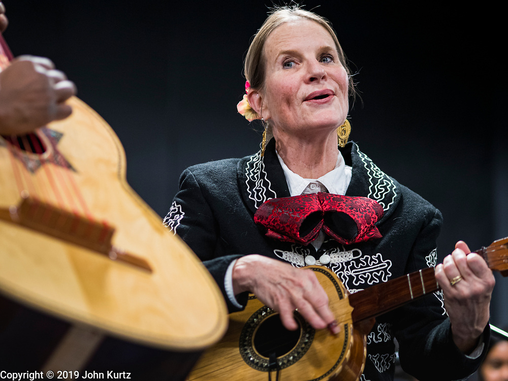 11 DECEMBER 2019 - DES MOINES, IOWA: KARIN STEIN, director of the OLOA (Our Lady of the Americas) Mariachis performs during the Virgin of Guadalupe celebration at Our Lady of the Americas Catholic Church in Des Moines. Virgin of Guadalupe Day is one of the most important holy days in Mexican Catholicism. It marks Dec. 12, 1531, the day Juan Diego, an indigenous Mexican peasant, saw an apparition of the Virgin Mary on a barren hillside in what is now Mexico City. A basilica was built on the site. Virgin of Guadalupe Day is celebrated throughout Mexico and in Mexican communities in the United States.               PHOTO BY JACK KURTZ