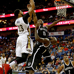 Jan 20, 2017; New Orleans, LA, USA; New Orleans Pelicans forward Anthony Davis (23) shoots over Brooklyn Nets forward Quincy Acy (13) and guard Isaiah Whitehead (15) during the second quarter of a game at the Smoothie King Center. Mandatory Credit: Derick E. Hingle-USA TODAY Sports