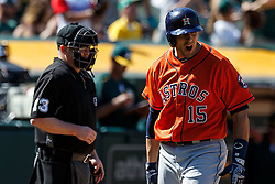 OAKLAND, CA - MAY 01: Jason Castro #15 of the Houston Astros reacts after a called third strike by umpire Todd Tichenor #13 during the ninth inning against the Oakland Athletics at the Oakland Coliseum on May 1, 2016 in Oakland, California. The Houston Astros defeated the Oakland Athletics 2-1. (Photo by Jason O. Watson/Getty Images) *** Local Caption *** Jason Castro; Todd Tichenor