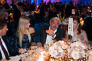 KARIN SCHONBLACHER; ROBERT TCHENGUIZ, Grey Goose character and cocktails. The Elton John Aids Foundation Winter Ball. off Nine Elms Lane. London SW8. 30 October 2010. -DO NOT ARCHIVE-© Copyright Photograph by Dafydd Jones. 248 Clapham Rd. London SW9 0PZ. Tel 0207 820 0771. www.dafjones.com.