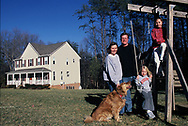 An American family in the 1980's. Photographed for the WASHINGTONIAN magazine on a series about the Great Places to Live in the Washington area.  This family lived in Warenton, Virginia<br /> <br /> Photo by Dennis Brack