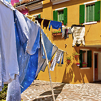 Clothing hanging to dry outdoors in Italy. Near Venice, in Burano.