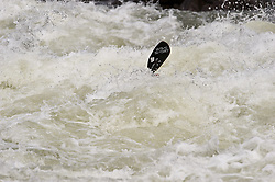 Only the kayak paddle can be seen as the kayker powers their kayak through the rapids at Pillow Rock on the Gauley River during American Whitewater's Gauley Fest weekend. The upper Gauley, located in the Gauley River National Recreation Area is considered one of premier whitewater rivers in the country.