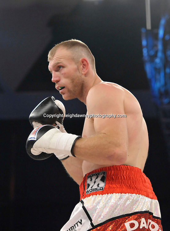 Nick Blackwell defeats Nathan King (pictured) in a middleweight boxing contest at Glow, Bluewater, Kent on the 8th November 2014. Promoter: Hennessy Sports. © Leigh Dawney Photography 2014.