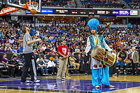 A member of bhangra troupe Ankhiley Gabroo performs during halftime for Sikh Appreciation Night at the Sacramento Kings basketball game.