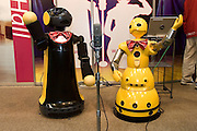WAKAMARU (right) from Mitsubishi Heavy Industries, Ltd. and ROBOVIE-R2 (left) from ATR Intelligent Robotics and Communication Laboratories, partner robots, interact in a comic dialogue. Tokyo Big Sight - 2005 INTERNATIONAL ROBOT EXHIBITION - TOKYO
