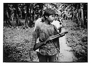 Rendezvous with MILF boy fighter with aging American weapon bought from Philippine Military, Coconut Plantation north of Cotabato, Mindanao, Philippines.