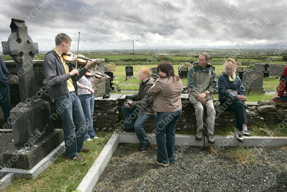 Musician Declan McLaughlin, Suzan McCallan, Malachy Crudden and Laura Williamson from mcPeakes School of Music Belfast performing at the Musical Tribute at Willie Clancy's Grave during the 33rd Willie Clancy Summer School in Milltown Malbay Co. Clare.  <br /> Pic.Brian Gavin/Press 22