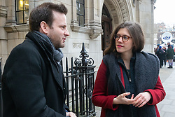 Bild journalist Philip Fabian speaks to Georgina Wight from the Institute for Government about the Brexit debate taking place across the street in the Houses of Parliament . London, January 15 2019.