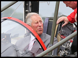 Image licensed to i-Images Picture Agency. 11/07/2014. Windsor, United Kingdom. The Prince of Wales in the cockpit of a Red Arrows jet after he met the pilots as part of the celebrations for  the Red Arrows 50th anniversary display season at the Royal International Air Tattoo at RAF Fairford, Gloucestershire,  United Kingdom. Picture by Stephen Lock / i-Images