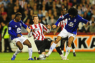 London - Tuesday, 21st September, 2010: Michael Spillane of Brentford and Magaye Gueye & Marouane Fellani of Everton during the Carling Cup 3rd Round match at Griffin Park, London...Pic by: Alex Broadway/Focus Images