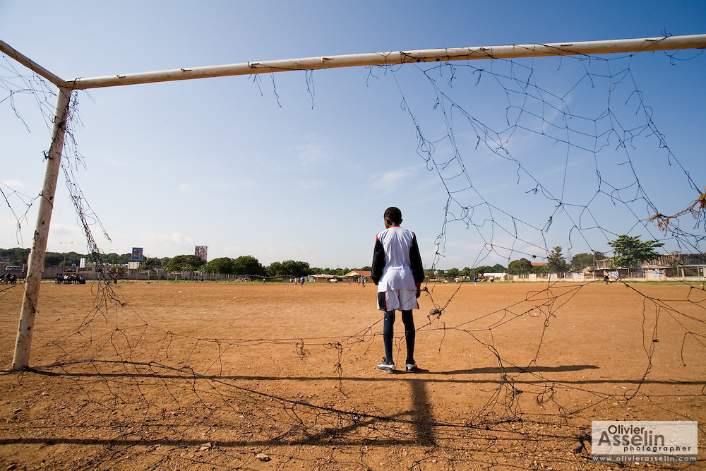 Boy standing in football goal in Accra, Ghana, 2006.