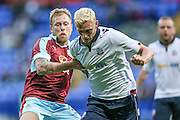 Scott Arfield (Burnley) pulls back Dean Moxey (Bolton Wanderers) during the Pre-Season Friendly match between Bolton Wanderers and Burnley at the Macron Stadium, Bolton, England on 26 July 2016. Photo by Mark P Doherty.