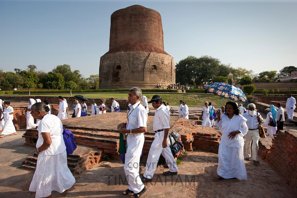 Sri Lankan Buddhist visitors at Dhamakh Stupa at Sarnath ruins near Varanasi, Benares, Northern India