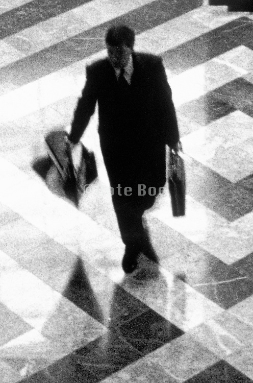 business man hurrying across lobby floor