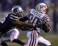 Kansas State linebacker Brandon Archer (L) reaches for Florida Atlantic running back Charles Pierre (R) in the first half at Bill Snyder Family Stadium in Manhattan, Kansas, September 9, 2006.  The Wildcats beat the Owls 45-0.