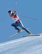 2/10/06 -- The 2006 Torino Winter Olympics -- Sestriere , Italy.USA Team skier Steven Nyman comes off the first jump of the men's downhill course in Sestriere, Italy during his second training run..Photo by Scott Sady, ..Photo by Scott Sady, USA TODAY staff.