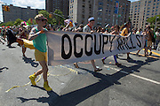 Occupy Wall Street carries its banner in the parade.