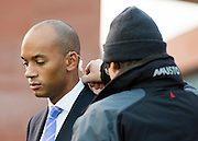 © Licensed to London News Pictures. 23/09/2014. Manchester, UK. Chuka Umunna has a earpiece fitted before giving  an early morning television interview. Labour Party Conference 2014 at the Manchester Convention Centre today 23 September 2014. Photo credit : Stephen Simpson/LNP