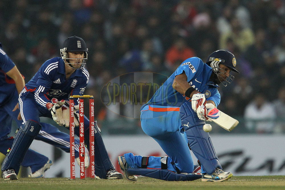 Yuvraj Singh of India  is dismissed LBW by James Tredwell of England during the 4th Airtel ODI Match between India and England held at the PCA Stadium, Mohal, India on the 23rd January 2013..Photo by Ron Gaunt/BCCI/SPORTZPICS ..Use of this image is subject to the terms and conditions as outlined by the BCCI. These terms can be found by following this link:..http://www.sportzpics.co.za/image/I0000SoRagM2cIEc