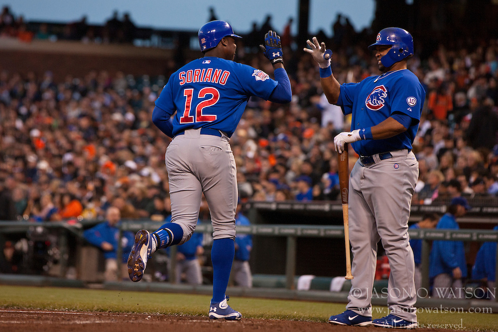 August 30, 2011; San Francisco, CA, USA;  Chicago Cubs left fielder Alfonso Soriano (12) is congratulated by center fielder Marlon Byrd (right) after hitting a home run against the San Francisco Giants during the second inning at AT&T Park.