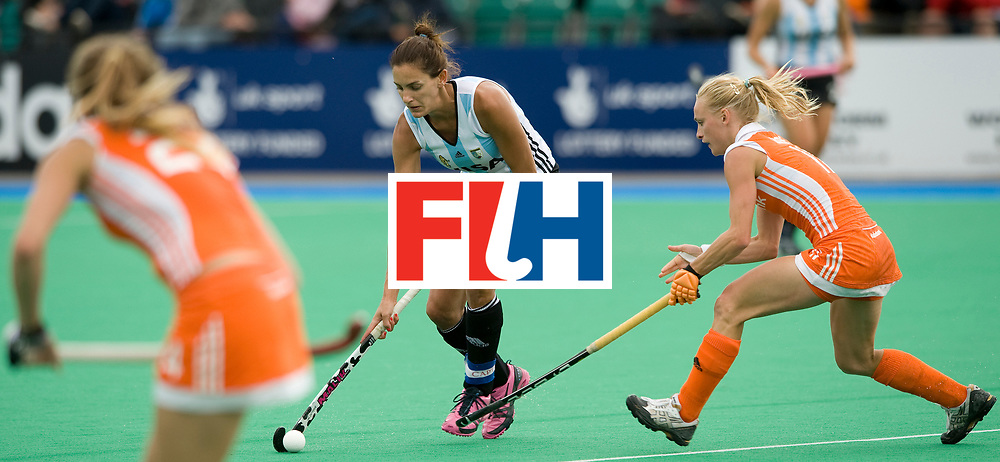 Argentina's Luciana Aymar challenges with Netherlands' Maartje Goderie during their Women's Champions Trophy Final at Highfields, Beeston, Nottingham, 18th July 2010.