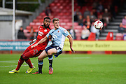 Crawley Town Forward Adi Yussuf (21) and Blackpool midfielder Jim McAlister (4) fight for possession during the EFL Sky Bet League 2 match between Crawley Town and Blackpool at the Checkatrade.com Stadium, Crawley, England on 1 October 2016. Photo by David Charbit.