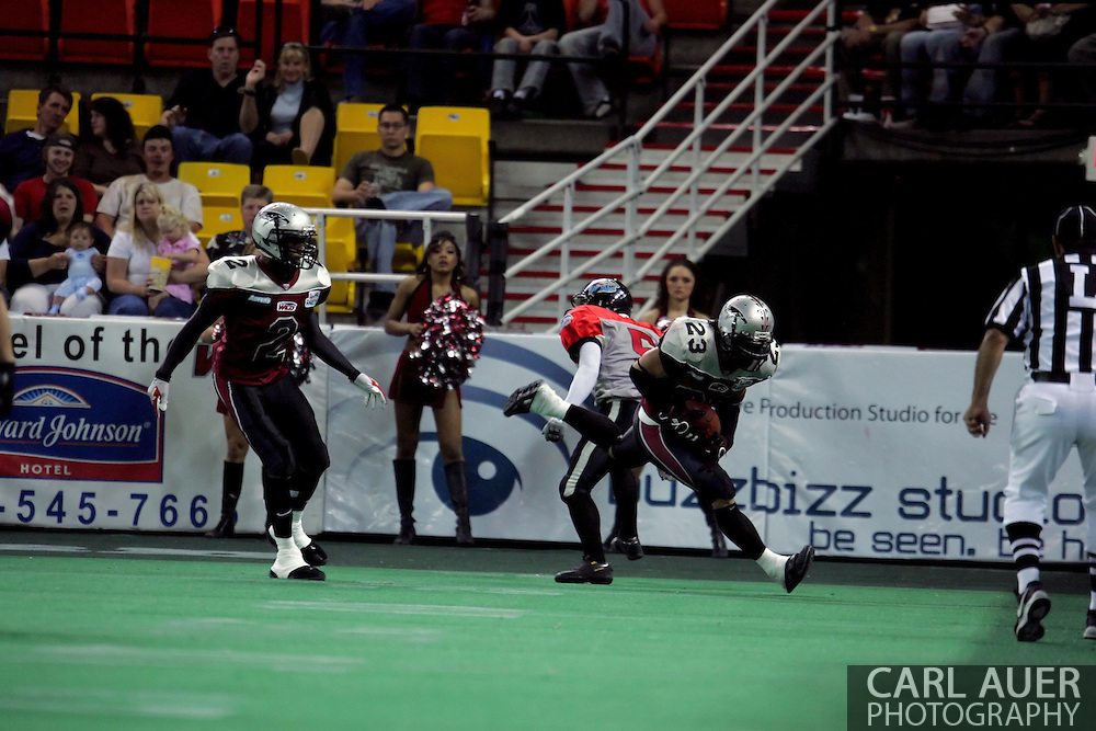 6-28-2007: Anchorage, AK - Donny Delaney of Alaska makes a spectacular touchdown robbing interception in the Alaska Wild 47 to 53 loss to the CenTex Barracudas at the Sullivan Arena...