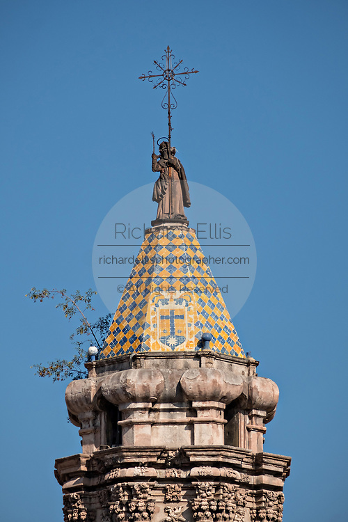 The tiled bell tower on the Baroque Churrigueresque style Iglesia del Carmen church and convent in the historic center on the Plaza del Carmen in the state capital of San Luis Potosi, Mexico.