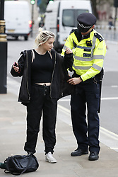 © Licensed to London News Pictures. 07/10/2019. London, UK. Police carry out a stop and search in Whitehall before Extinction Rebellion protestors start converging in central London . Activists will converge on Westminster blockading roads in the area for at least two weeks calling on government departments to 'Tell the Truth' about what they are doing to tackle the Emergency. Photo credit: Peter Macdiarmid/LNP