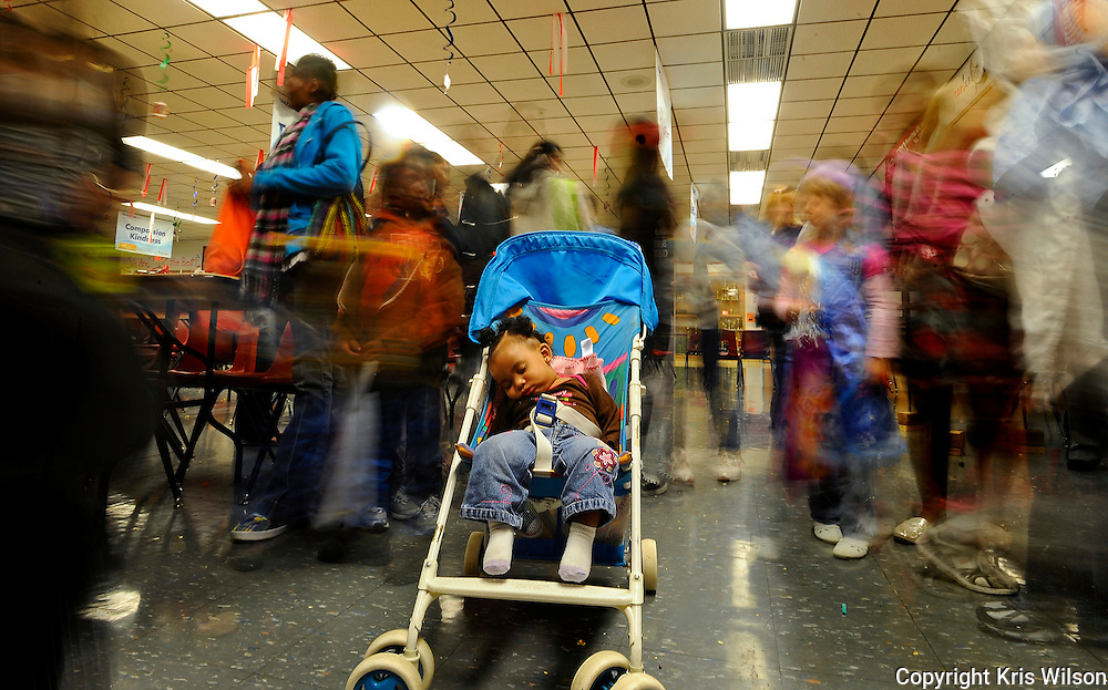 8-month-old Addisyn Brown snoozes in her stroller despite the commotion around her during the annual Jack-O-Lantern Jam at Jefferson City High School. JCHS student clubs and organizations host the event each year for elementary-aged children and their parents or guardians.
