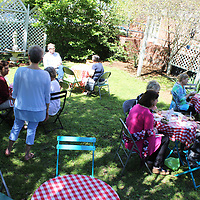 People gather for lunch at The Culinary Workshop's luncheon in the garden at the First Presbyterian Church.