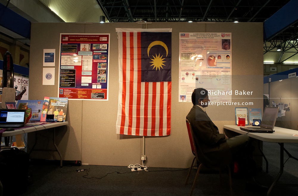 A patient Malaysian entrepreneur awaits investment for his concept at an inventors fair in Alexandra Palace, London