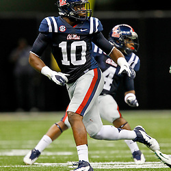September 22, 2012; New Orleans, LA, USA; Ole Miss Rebels defensive end C.J. Johnson (10) pursues a play against the Tulane Green Wave during a game at the Mercedes-Benz Superdome. Ole Miss defeated Tulane 39-0. Mandatory Credit: Derick E. Hingle-US PRESSWIRE