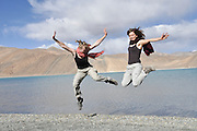 Young European tourists on the shores of Pangong Tso (Pangong lake), India, Jammu and Kashmir, Ladakh