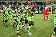Macot with Forest Green Rovers Ebou Adams(14) during the EFL Sky Bet League 2 match between Forest Green Rovers and Scunthorpe United at the New Lawn, Forest Green, United Kingdom on 7 December 2019.